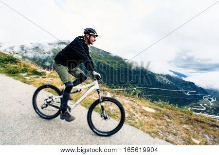 Young Man Cycling. Shot taken in Switzerland, near Rhone Glacier and Furka Pass.