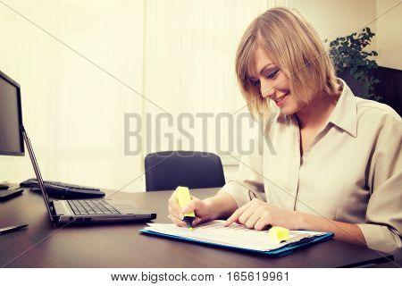 Blonde Businesswoman Highlighting Chart. Business Concept