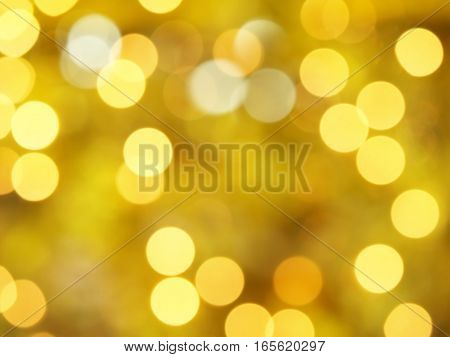 defocused yellow gold Christmas lights bokeh, blurred festive decorative lights abstract background