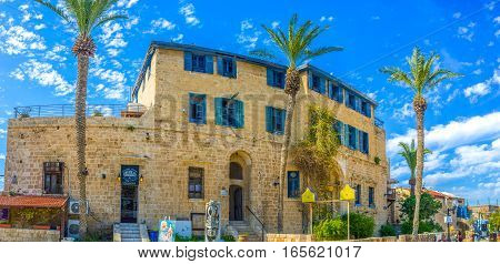TEL AVIV ISRAEL - FEBBRUARY 25 2016: Walking along the Kikar Kedumim square - the best place in Jaffa to visit cafe souvenir shop or art gallery on February 25 in Tel Aviv.