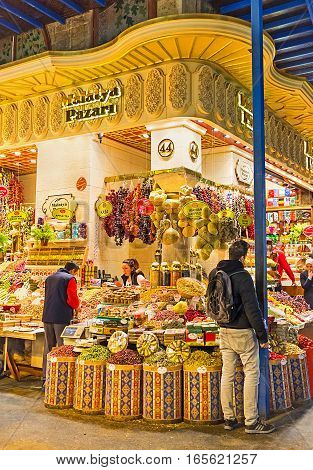 ISTANBUL TURKEY - JANUARY 21 2015: The market stall with the wide range of turkish delight tea and spices in bulk and the gift sets with local specialities on January 21 in Istanbul.