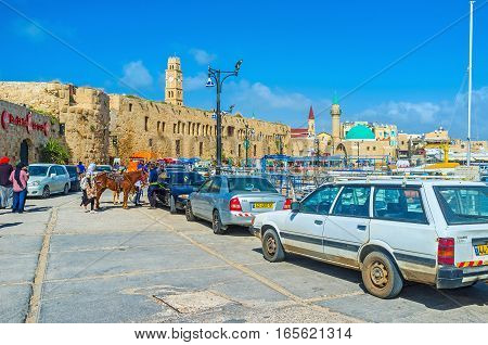 ACRE ISRAEL - FEBRUARY 20 2016: The central promenade of Akko stratches along the port and boasts various cafes fish taverns luxury restaurants and bars on February 20 in Acre.