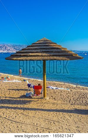 The tourists having sunbathes on the beach of Eilat Israel.