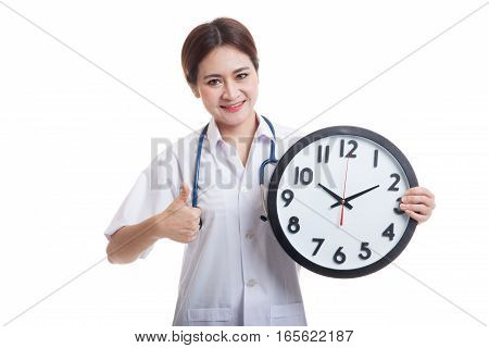 Young Asian Female Doctor Thumbs Up With A Clock.