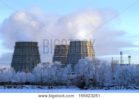 Cooling towers in morning dawn frosty morning