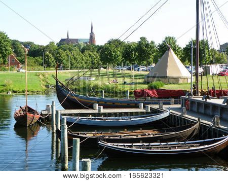 Moored Boats at the Pier and Roskilde City's Famous Landmark St. Luke Cathedral, Roskilde, Denmark