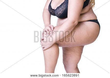 Plus size model in black lingerie overweight female body fat woman with thick thighs posing isolated on white background