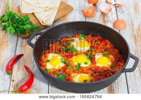 Basic Shakshuka  In Cast Iron Pan With Ingredients