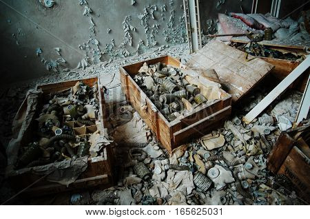 Infected Radiation Gas Masks On The Floor At Boxes At Chernobyl Nuclear Power Plant Zone Of Alienati