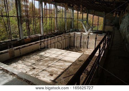 Lost School Sport Gym With Swimming Pool At Chernobyl City Zone Of Radioactivity Ghost Town.