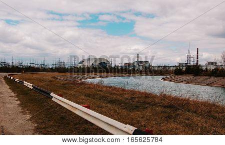 Chernobyl Alienation Zone. View Of Chernobyl Atomic Plant Background River.