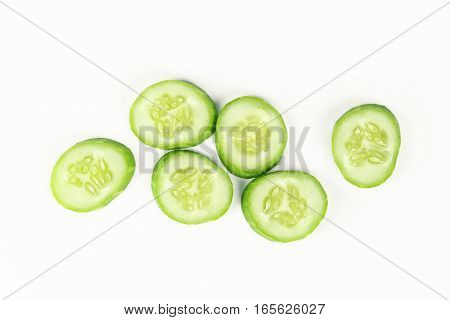 fresh sliced cucumber on white background, raw organic vegetable