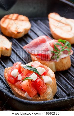 Set Of Bruschetta In The Grill Pan. Close Up.