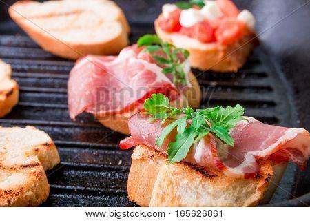 Crostini With Arugula And Prosciutto. Italian Food, Homemade Bruschetta.