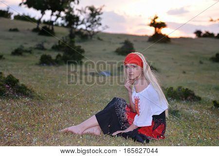 Beautiful Blonde Woman On Field At Sunset, Summer Evening