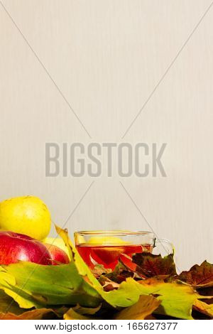 Apples On The Table With A Cup Of Tea With Lemon Maple Leaves