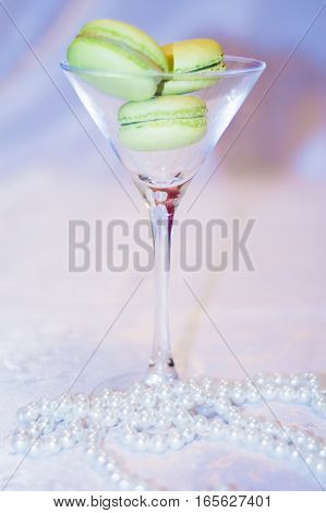Cocktail Glass With Dessert Macarons It