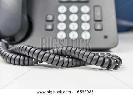 Spiral line of IP Phone on the white table