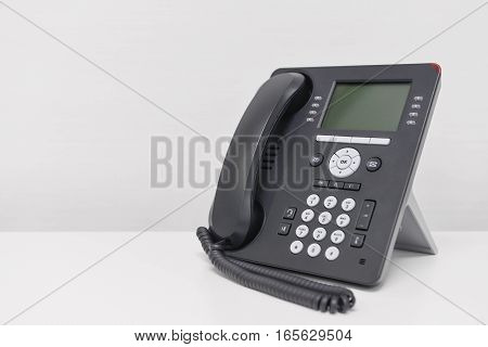 Black IP Phone on the white screen