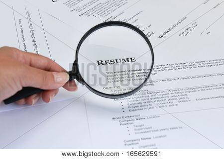 Searching Resume - Concept for using Magnifying Glass to find the Resume of candidate