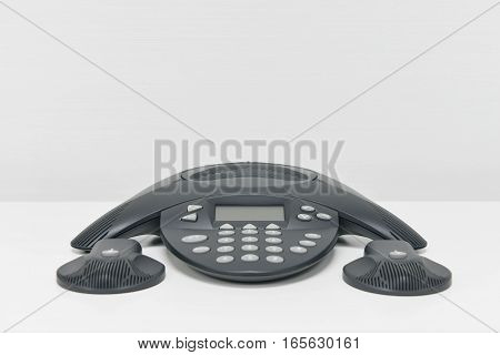 IP Phone - IP Conference device on the white table with mic