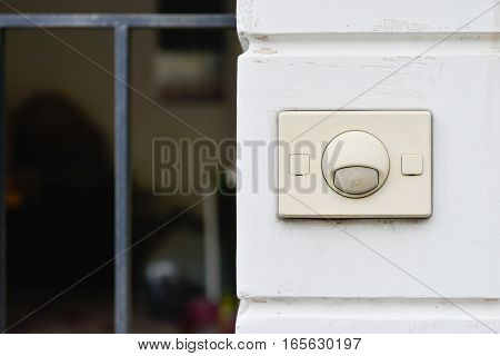 Old doorbell at the front of the home