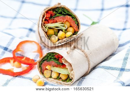 Healthy wraps with salmon and chickpeas for lunch. Love for a healthy food concept