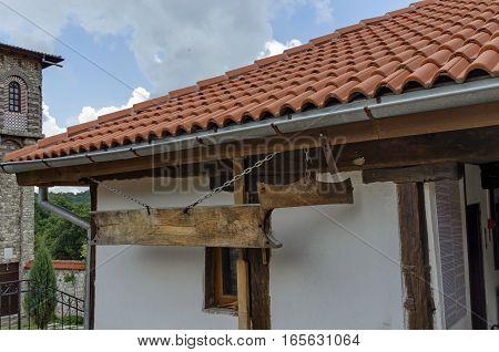 Monastery wooden clapper in Gigintsy monastery, Bulgaria