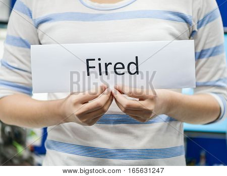Business woman is holding the fired letter