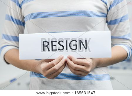 Business woman is holding the resignation letter