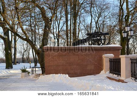 Gomel Palace and Park Ensemble in winter. Cannon on parapet in park