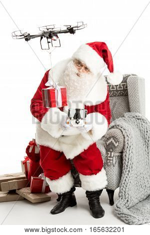 Santa Claus sitting on grey armchair using hexacopter drone