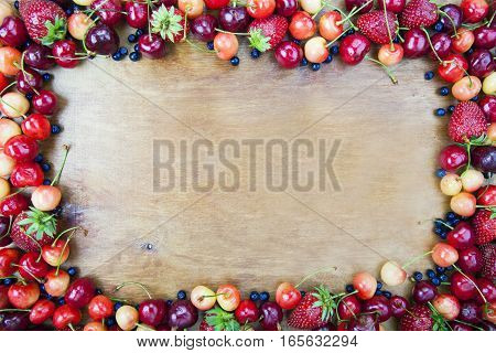 Frame From Fruit On The Background Of Wooden Boards