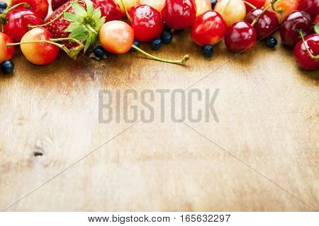 Many Fresh Fruits Lie On A Wooden Board