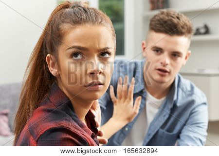 Teenage Couple At Home Having Relationship Difficulties