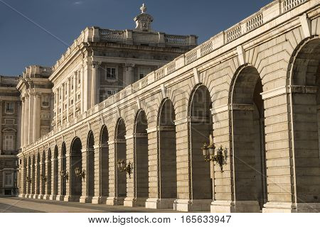 Madrid (Spain): the historic Royal Palace a colonnade