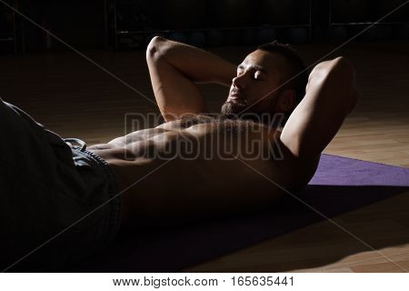 Fitness Model Exercising Sit Ups And Crunches. Muscular Well Build, Toned Body With Six Pack Sweatin