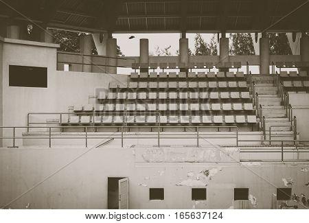 old green tennis stadium vintage tone , sitting