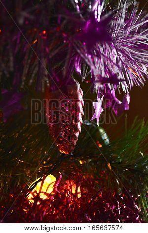 lights of garlands and toys on new year tree