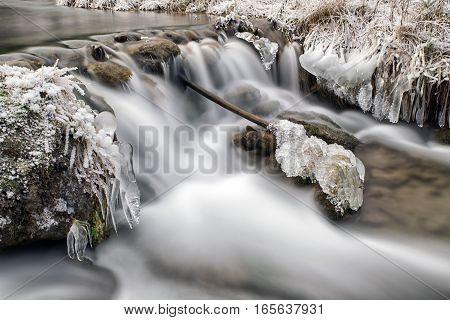 Long exposure stream in winter. Cutkovska valley, Slovakia