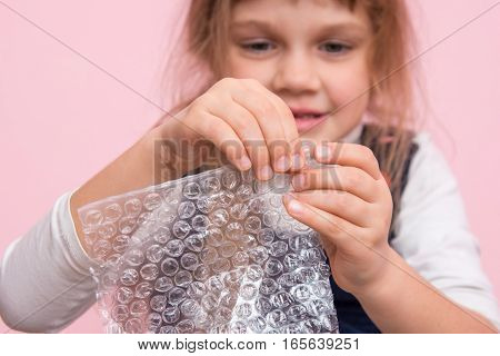 Girl Eats Balls On The Wrapping Paper, Close-up