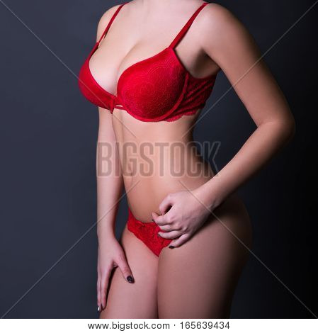 Close Up Of Sexy Female Body In Red Lace Lingerie Over Dark Gray