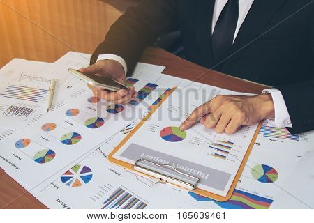 Businessman Check Business Report.