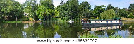 ST NEOTS, CAMBRIDGESHIRE, ENGLAND - JULY 24, 2016: Panorama of the River Ouse at St Neots with Narrow Boat.