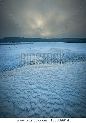 Frozen Water Reservoir On Fields. Winter Landscape.