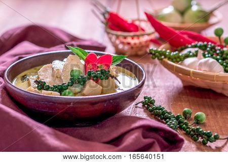 Chicken Mussaman Curry In Bowl Vegetables On Wooden Background