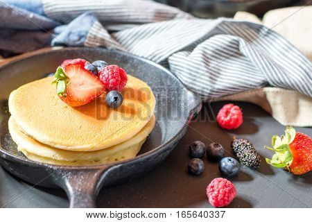 Home Made Pancakes With Berries On Metal Frying Pan Decorated With Berries (blueberries, Raspberries