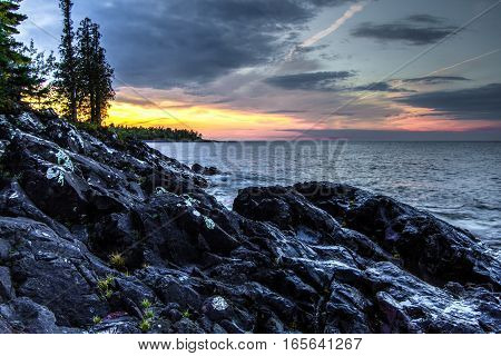 Northern Michigan Lake Superior Sunset. Rocky coast and cliffs on the shores of Lake Superior at sunset in Michigan's Upper Peninsula in Copper Harbor.