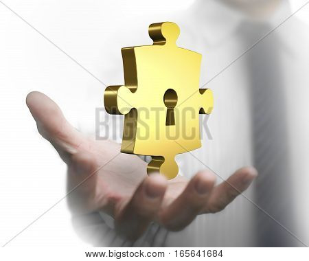 Man Hand Showing Golden Puzzle Piece With Keyhole
