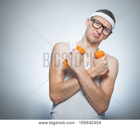 Funny Weak Man Holding Dumbbells
